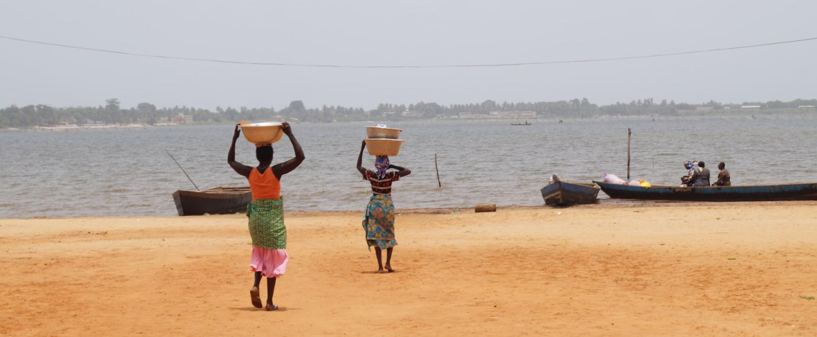 Local women in Togoville with buckets of water